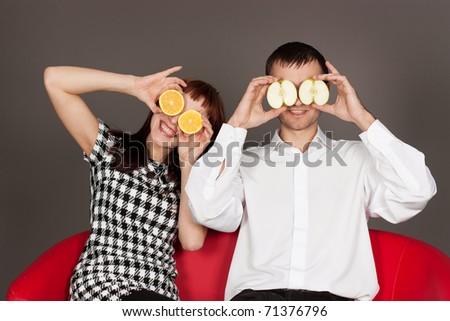 Morimos??? XD ¿y... por que no? - Página 18 Stock-photo--funny-couple-shutting-eyes-with-apple-and-orange-in-studio-against-gray-71376796