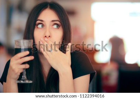 Funny Girl Reacting after Drinking Frizzy Soda Drink. Woman covering her moth after drinking cola