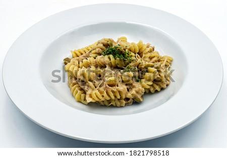 Fusilli with tuna and parsley, italian pasta, isolated on white background.  Foto d'archivio ©