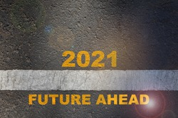 2021 future ahead written on road surface with starting line. Beginning challenge new year concept and business success idea