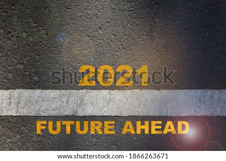Photo of  2021 future ahead written on road surface with starting line. Beginning challenge new year concept and business success idea