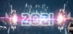 2021 futuristic tehcnology trend concept,  hand man and robot hand pointing together in concept futuristic in 2021 coming year the year of artificial intelligence ,big data, iot, augmented reality