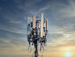 4G and 5G cellular. Macro Base Station or Base Transceiver Station. Telecommunication tower. Wireless Communication Antenna Transmitter. Development of communication systems in urban area at sunset.