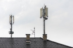 5G antennas on top of house. Antennas and transmitters on roof. High speed mobile internet concept.