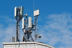 5G Cell Towers on sky background