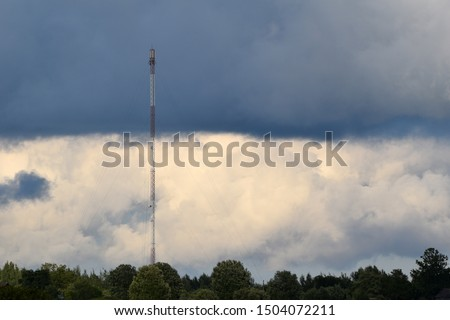 4g internet tower in countryside. Dramatic sky in the background.