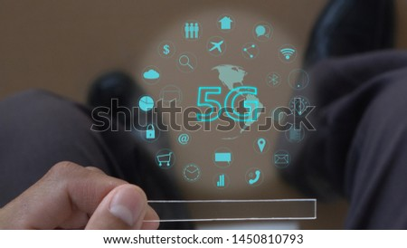5G technology. Futuristic technology in hand. modern data hologram with application media in glass technology #1450810793