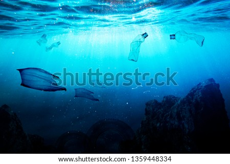 Garbage instead of fish in the sea. Plastic and pollution in oceans concept. #1359448334