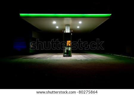 Gas station at night.