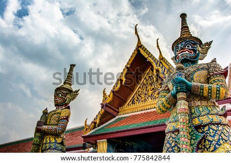 2 Giant demons guarding an exit in Wat Phra Kaew( Temple of the Emerald Buddha) in Bangkok, Thailand