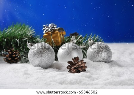 gift  and silver balls on snow in Christmas nignt