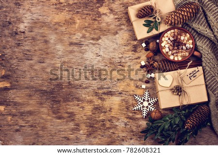 gift, fir branch, nuts, cones, Cocoa, coffee, cozy knitted blanket. Winter, New Year, Christmas still life.  #782608321