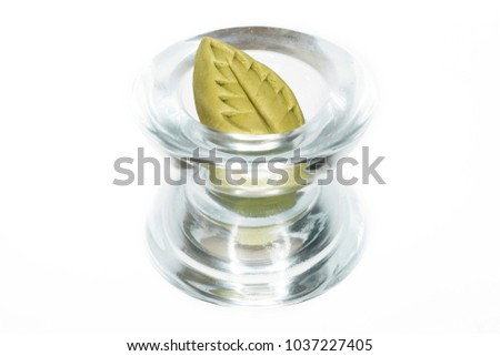 Ginger and wasabi for sushi in glass, on white background.  #1037227405