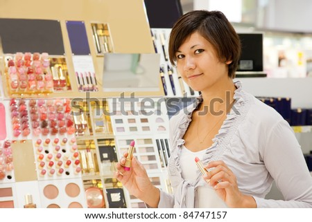 girl buying cosmetic at cosmetics  shop