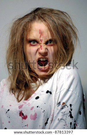 girl in a theatrical image of the furious zombie for holiday halloween