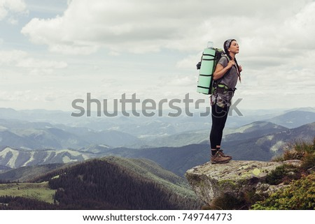 girl in mountains mountaineering Travel Lifestyle concept landscape on background vacations adventure journey outdoor, human and nature.