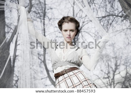 girl in park played with  fabric  wind - stock photo