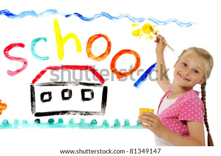 Girl painting the word SCHOOL - stock photo