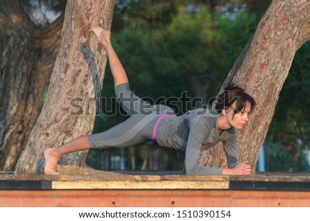 girl performs an exercise plank. exercise in the morning.