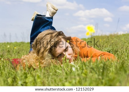 "girl relaxing on the grass, ""outdoor freedom"""