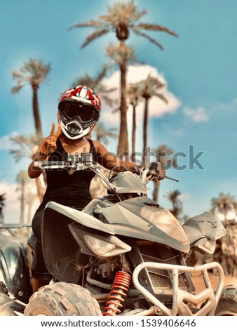 Girl sitting on a quad in the desert Stock photo ©