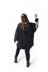 girl view from the back in a black tunic on a white background