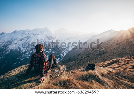 Girl Watching Sunset From Mountain Top on the Italian Alps - Shutterstock ID 636294599