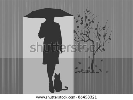 Girl with a cat under the umbrella.Autumn.
