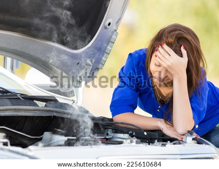 girl with beautiful hair and broken down car