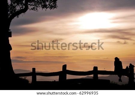 girl with sunset on the hill in silhouette