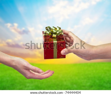 """Give and take"" Gift box on hand to hand"