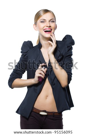 glamorous girl in a black jacket with a bottle of perfume in her