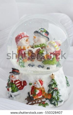 glass Christmas ball with snowman