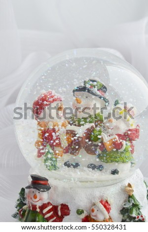 glass Christmas ball with snowman