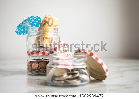 3 glass jars with Euro notes, sunshade, 2€ coins and loose cash for housekeeping and vacation savings #1502939477