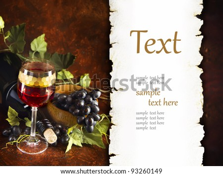 glass of wine with grapes (With sample text)
