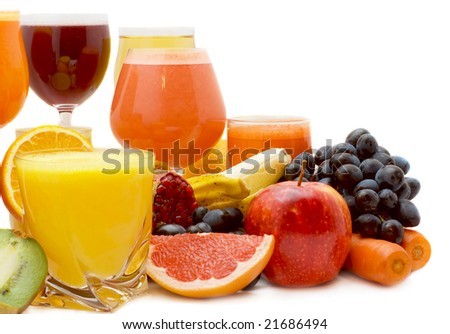 Glasses of fresh juice from different fruit - stock photo