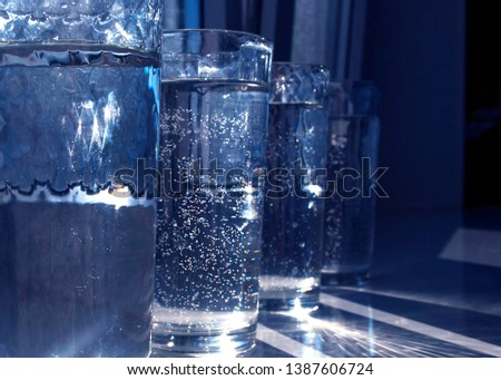glasses with clear clear water #1387606724