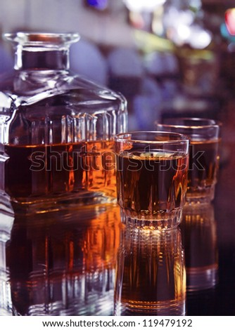 glasses with whiskey on a glass table