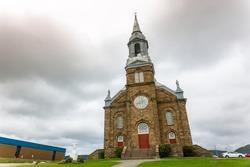 Église catholique Saint-Pierre Roman Catholic Church, Roman, a 120 year old roman catholic church located in Cheticamp, Cape Breton, Nova Scotia, Canada