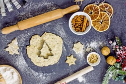 Gluten Free Christmas Cookies. Making homemade Christmas tree gluten-free cookies. Rolled dough and cutting molds, top view, flat lay,  top view. Healthy cookies for the new year