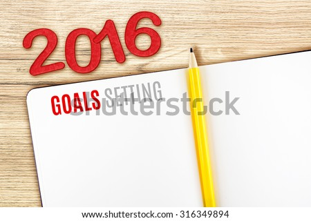 2016 Goals Setting word on notebook lay on wood table,Template mock up for adding your goal.