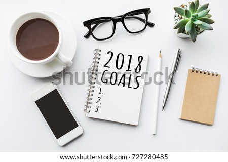 2018 goals text on notepad with office accessories.Business motivation,inspiration concepts