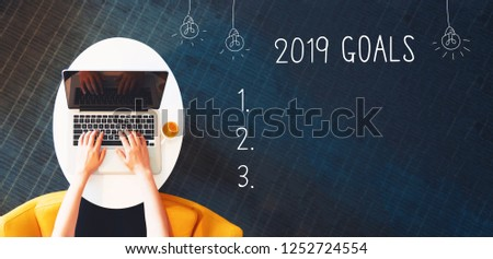 2019 goals with person using a laptop on a white table #1252724554
