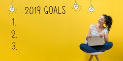 2019 goals with young woman using a laptop computer