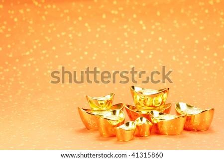 Gold ingot on a festive background.