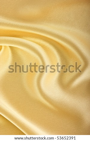 gold silk folds of fabric, closeup