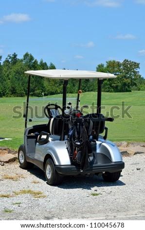 Golf cart and clubs at a course Georgia, USA