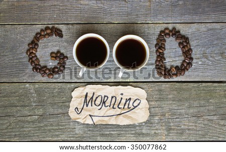 """good morning"" concept - coffee beans, Cup of black coffee. Toned image."