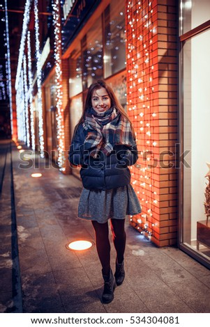 gorgeous brunette girl, portrait in night city lights
